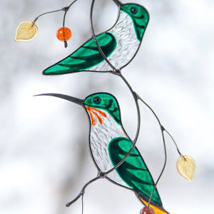 Zoomed hummingbirds of stained glass window hanging