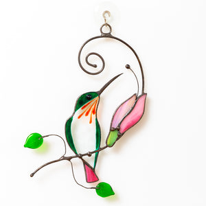 Suncatcher of a stained glass hummingbird with pink flower