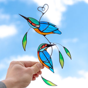 Stained glass suncatcher of a pair of kingfishers with leaves