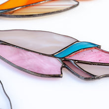 Load image into Gallery viewer, Zoomed stained glass pink feather with a blue part suncatcher