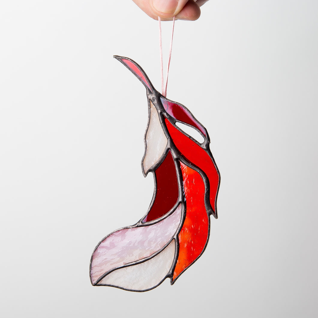 Red stained glass bending left feather suncatcher for window decoration