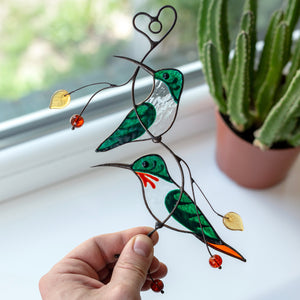 Green hummingbirds sitting on the branch stained glass window hanging