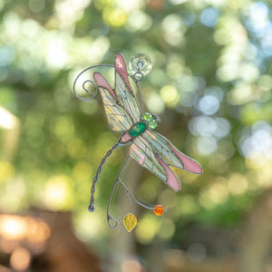 Pink stained glass dragonfly with iridescent wings suncatcher