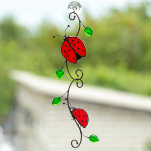 Two ladybugs sitting on the branch stained glass suncatcher