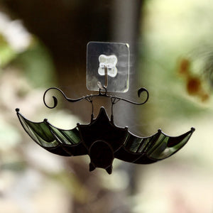 Black-and-clear stained glass bat suncatcher for Halloween celebrations