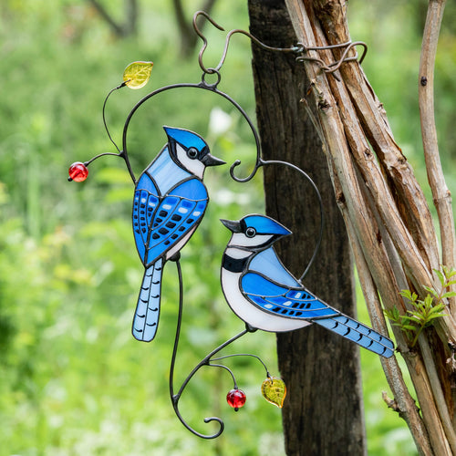 Stained glass bluejays suncatcher hanging on the tree