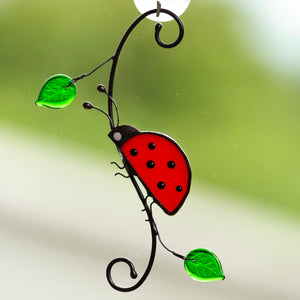 Side-view stained glass ladybug sitting on the branch suncatcher