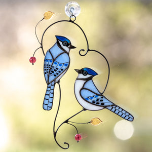 Stained glass pair of bluejays sitting on the branch suncatcher