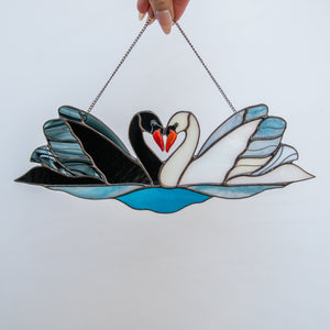 Suncatcher of black and white swans of stained glass