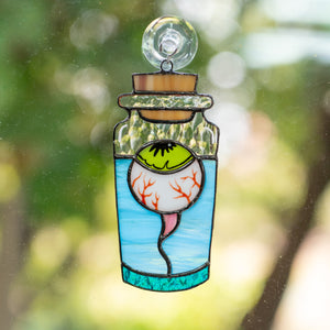 Stained glass torn out eye in the bottle suncatcher for Halloween decor
