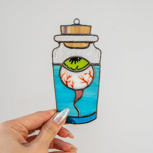 Stained glass torn out eye in the bottle suncatcher for spooky Halloween decor