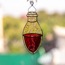 Load image into Gallery viewer, Halloween stained glass suncatcher of a bottle with blood