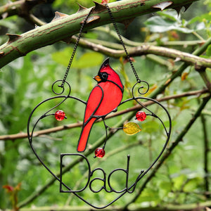 Personalized stained glass redbird sitting on a wire heart window hanging