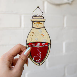 Bottle with blood suncatcher of stained glass for Halloween decor