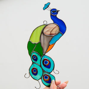 Colourful stained glass peacock window hanging