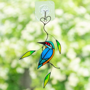 Stained glass colourful kingfisher on the branch suncatcher