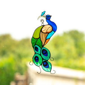 Bright peacock suncatcher of stained glass