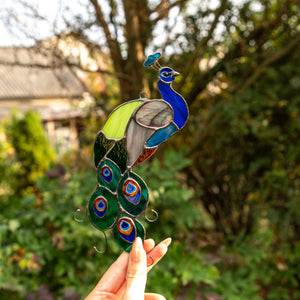 Stained glass peacock of bright colours suncatcher for window