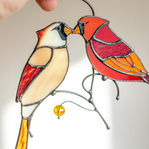 Zoomed stained glass cardinals kissing suncatcher