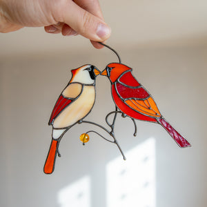 Stained glass cardinals kissing window hanging