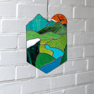 Stained glass panel of a landscape for window decor