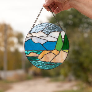 Stained glass round panel depicting the landscape of Lake Tahoe