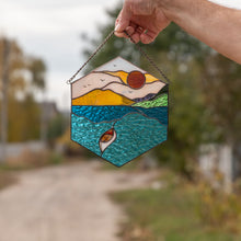 Load image into Gallery viewer, Stained glass hexagon panel depicting the setting sun, the water and the boat