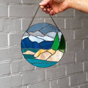 Stained glass panel depicting Lake Tahoe and its surrounding