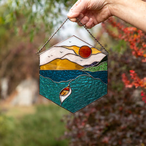 The waters and the boat stained glass panel for window decor