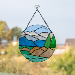 Lake Tahoe round panel of stained glass