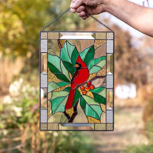 Stained glass panel of a cardinal on the branch with leaves and berries