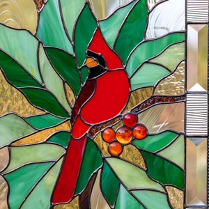 Zoomed stained glass panel depicting a red cardinal