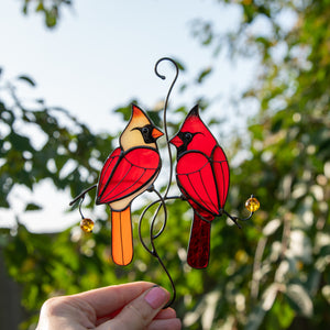 Stained glass window hanging of cardinals couple