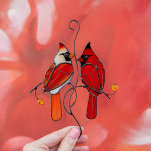 Colourful stained glass cardinals in love on the branch suncatcher