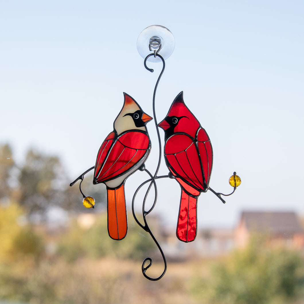 Stained glass cardinals couple on the branch with leaves and berries suncatcher
