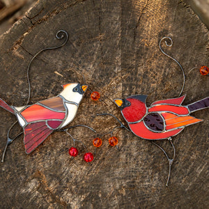 Zoomed stained glass make and female cardinals suncatchers