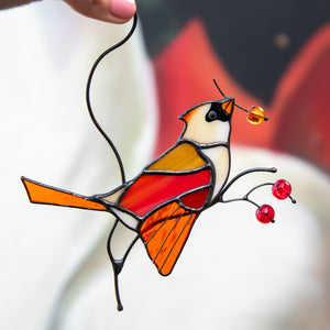 Female stained glass winter redbird sitting on the branch with berries suncatcher for window
