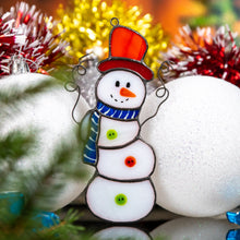 Load image into Gallery viewer, Stained glass Snowman suncatcher with the red hat and a blue scarf