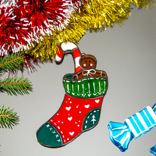 Stained glass window hanging of a Christmas stocking with candy cane