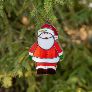 Santa Claus suncatcher as a New Year Tree decoration