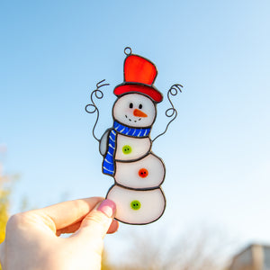 Funny snowman suncatcher of stained glass