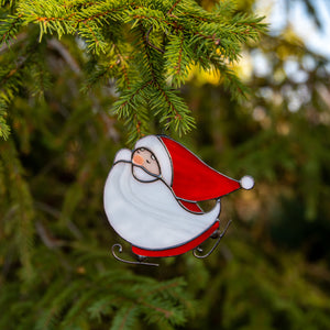 Stained glass skating Santa used as a New Year Tree decoration