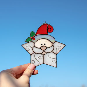 Cute stained glass Santa shaped as a snowflake window hanging