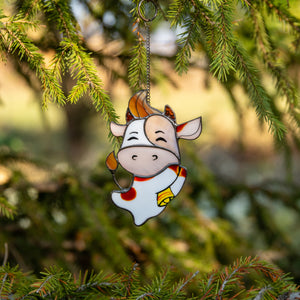 Happy cute bull stained glass window hanging as a New Year Tree decoration