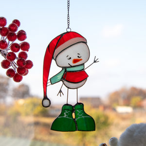 Snowman in a red hat and green boots window hanging of stained glass