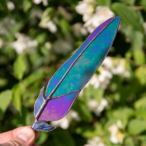 Stained glass raven feather with modulating colours suncatcher