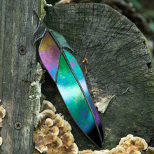 Load image into Gallery viewer, Suncatcher of a stained glass raven feather with modulating colours