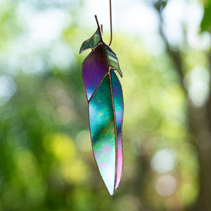 Window hanging of a stained glass raven feather for decor