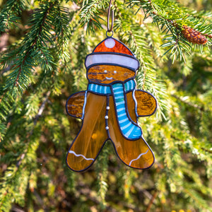 Stained glass cookie man suncatcher used as a New Year Tree decoration