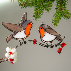 Set of two stained glass robin birds looking at each other